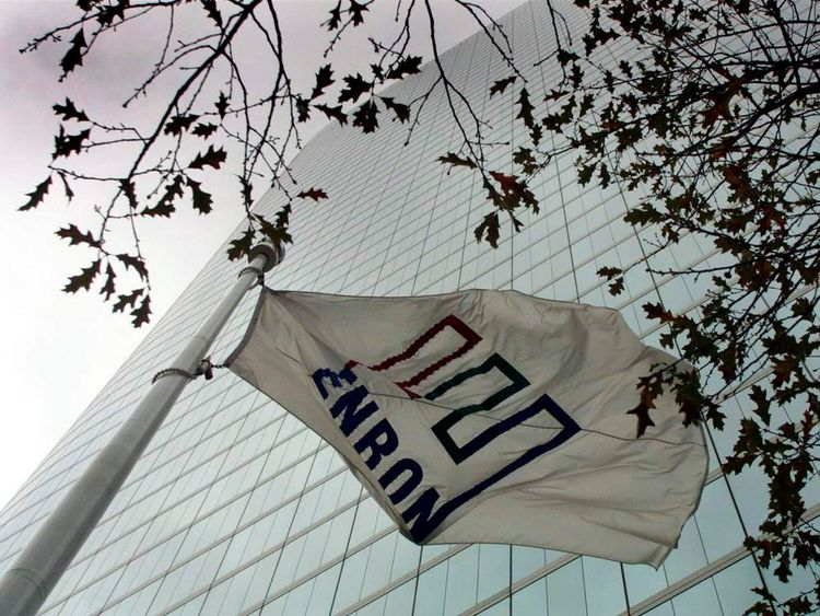 THE ENRON FLAG FLIES OVER COMPANY'S HOUSTON HEADQUARTERS IN 2002