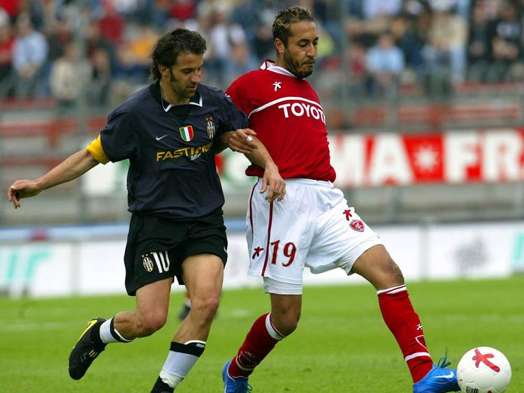 JUVENTUS'S DEL PIERO TACKLES GADDAFI OF PERUGIA DURING THEIR SERIE A MATCH IN PERUGIA.