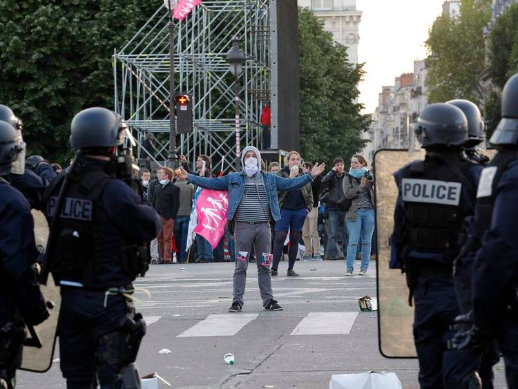 "Youth taunt police during incidents at the end of a protest march called, ""La Manif pour Tous"" (Demonstration for All) against France's legalisation of same-sex marriage, in Paris"