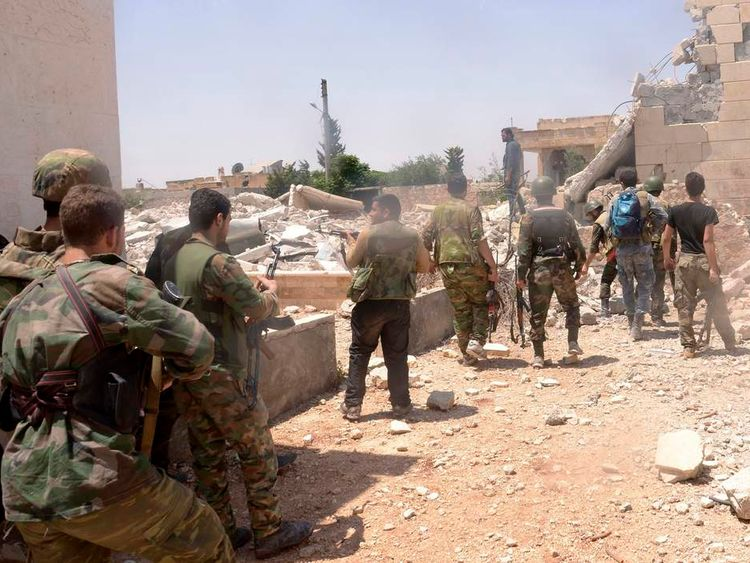 Forces loyal to Syria's President Assad