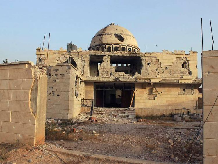 Damaged mosque is seen in Arjoun village near Qusair town, where forces of Syrian President Assad and rebel forces have been fighting