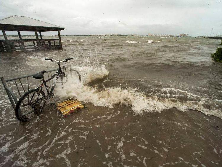 Water from Boca Ciega Bay washes ashore as wind and rain from Tropical Storm Andrea hit the Florida coast near Gulfport, Florida