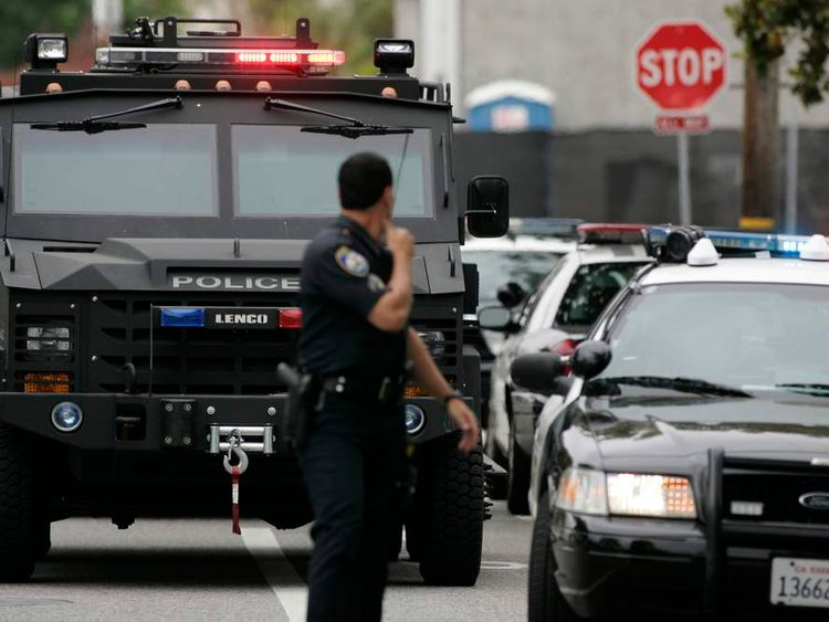 An armoured police vehicle is stationed on the street during a search at Santa Monica College following a shooting on campus in Santa Monica, California
