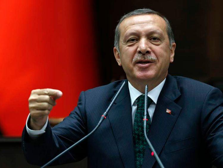 Turkey's PM Erdogan addresses members of parliament in Ankara