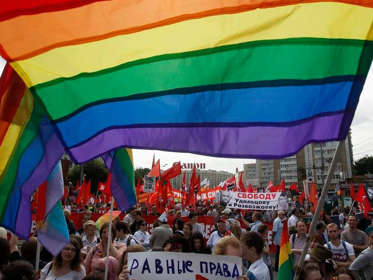 Gay rights activists take part in opposition protest march in Moscow