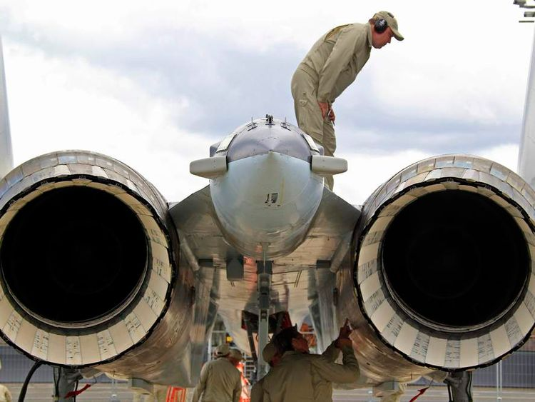 Engineers check specials vectored thrust jet engines of a Sukhoi Su-35 fighter after a flying display, two days before the Paris Air Show, at the Le Bourget airport near Paris