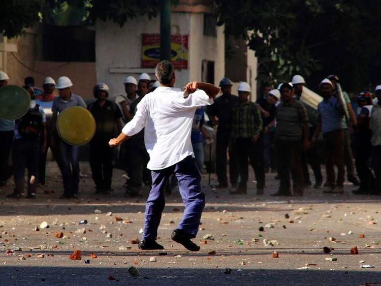 Supporters of Egyptian President Mohamed Mursi and anti-Mursi protesters clash in Sedy Gaber in Alexandria