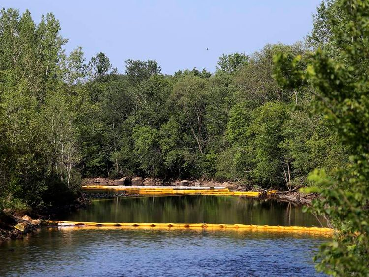 Barriers to contain crude oil are placed on La Chaudiere River near Lac Megantic, Canada