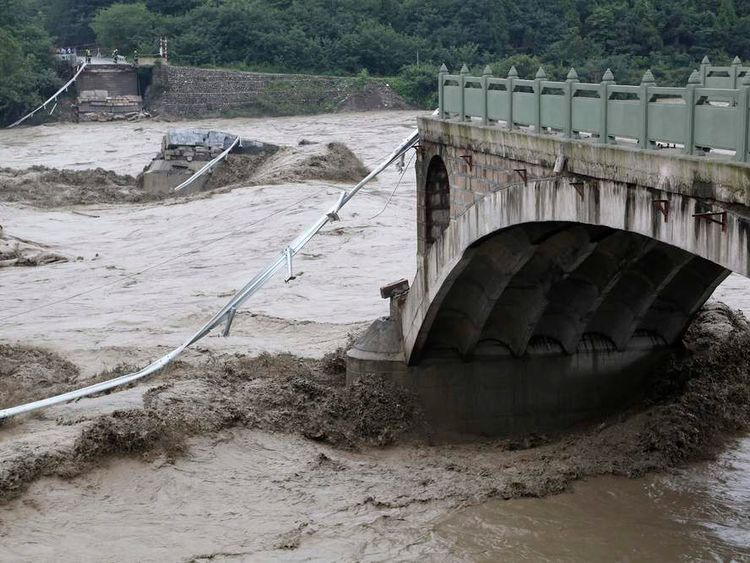 A bridge is collapsed after being hit by sweeping floods in Jiangyou