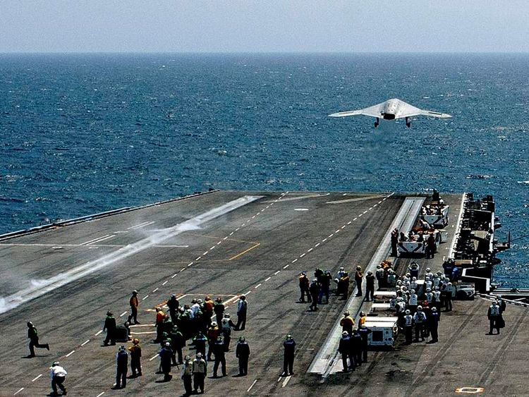 An X-47B pilot-less drone is launched from the deck of the USS George H.W. Bush aircraft carrier