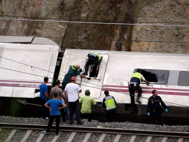 Rescue workers pull victims from a train crash near Santiago de Compostela.