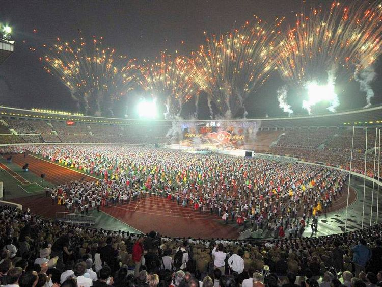 North Koreanss participate in a celebration event in Pyongyang