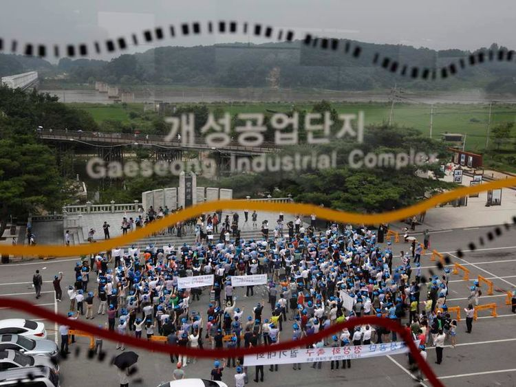 Protesters working at the Kaesong Industrial Complex (KIC) chant slogans during a rally at Imjingak pavilion