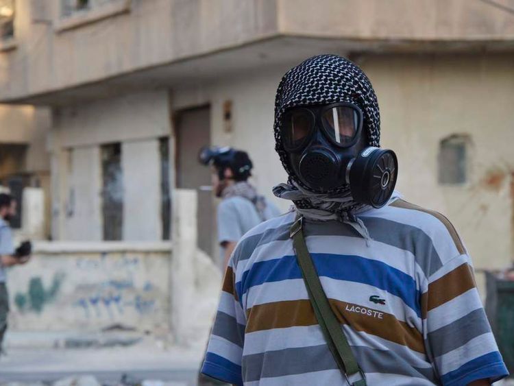 An activist wearing a gas mask is seen in the Zamalka area, where activists say chemical weapons were used by forces loyal to President Bashar Al-Assad in the eastern suburbs of Damascus