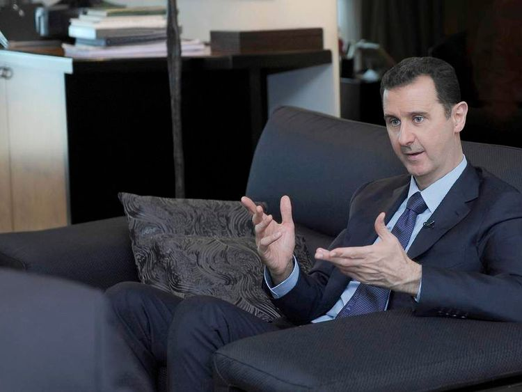Syria's President Bashar al-Assad speaks during an interview with Russian newspaper Izvestia
