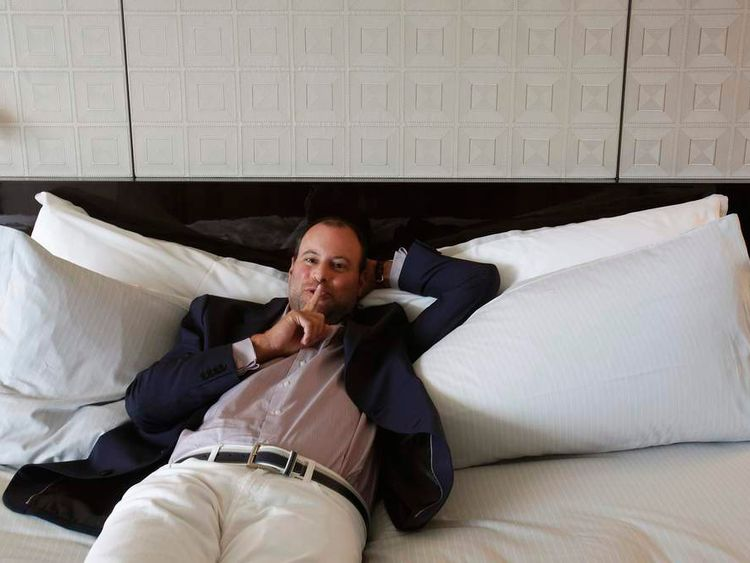 Ashley Madison founder Noel Biderman poses during an interview in Hong Kong
