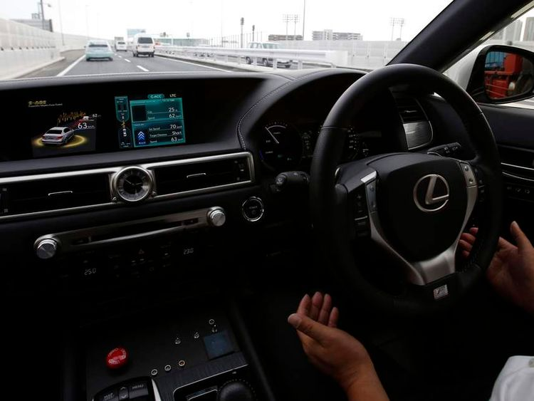 A Staff member of Toyota drives a test car on the Metropolitan Expressway without using hands to demonstrates the Automated Highway Driving Assist in Tokyo