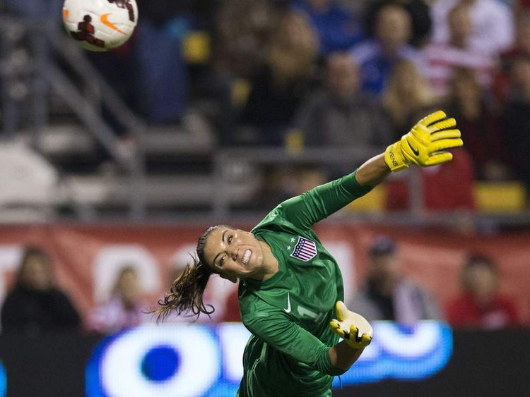 USA goalkeeper Hope Solo (1) can't stop a shot chipped over her by New Zealand forward Hannah Wilkinson (17)
