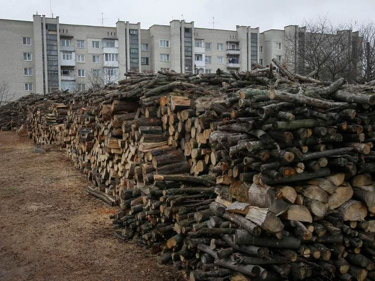 Wood is seen stacked in front of buildings in the western Ukrainian town of Zolochiv, in a boycott of Russia's Gazprom supplying energy