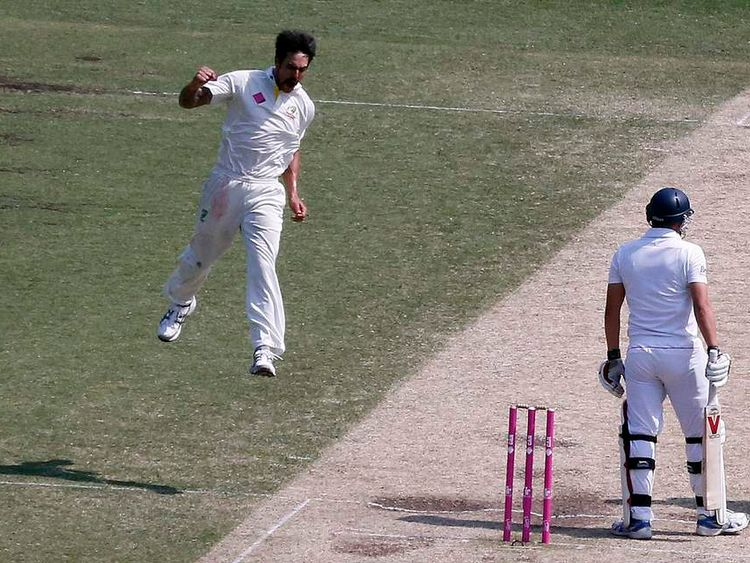 Australia's Johnson celebrates after taking the wicket of England's Ballance during the third day of the fifth Ashes cricket test at the Sydney cricket ground