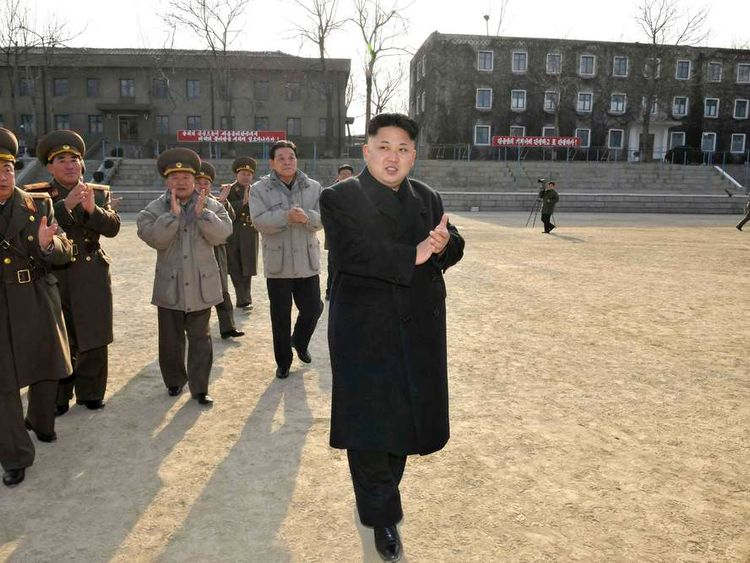 North Korean leader Kim Jong Un applauds as he inspects the command of the Korean People's Army Unit 534