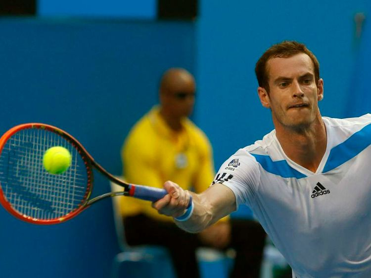 Andy Murray of Britain hits a return to Go Soeda of Japan during their men's singles match at the Australian Open 2014 tennis tournament in Melbourne