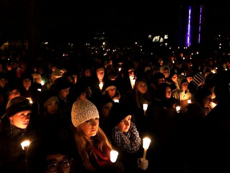 Purdue University students gather for a candlelight vigil in honor of Andrew Boldt following a campus shooting in West Lafayette