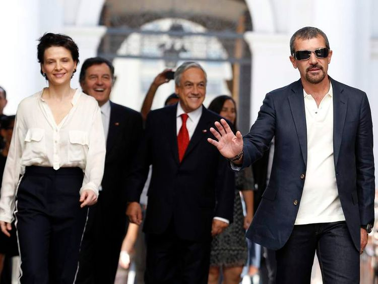 Actress Juliette Binoche, Culture Minister Roberto Ampuero, Chile's President Sebastian Pinera and actor Antonio Banderas arrive at the presidential palace in Santiago
