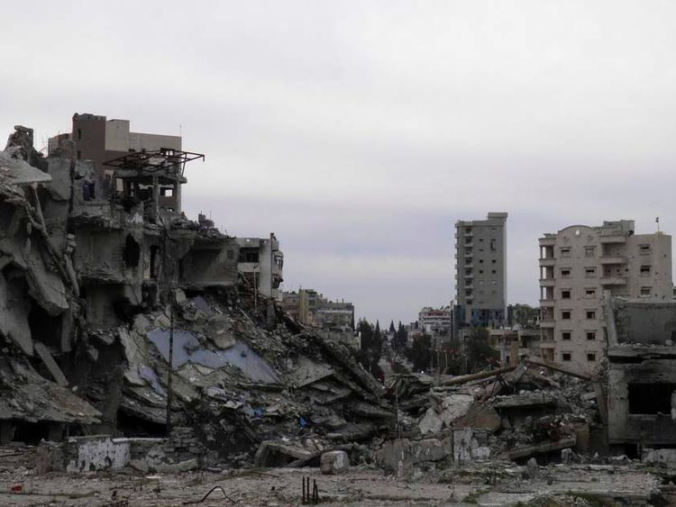 A general view of damaged buildings are seen in the besieged area of Homs