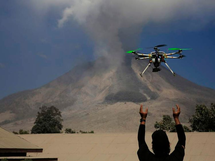 Quadcopter drone An official of the Center for Research and Technology Volcanoes Development (BPPTK) releases a drone quadcopter to monitor activity from the Mount Sinabung volcano at Sibintun village in Karo district