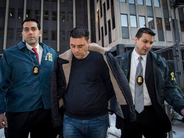 Gambino crime family associate Franco Lupoi is escorted by FBI agents from their Manhattan offices in New York
