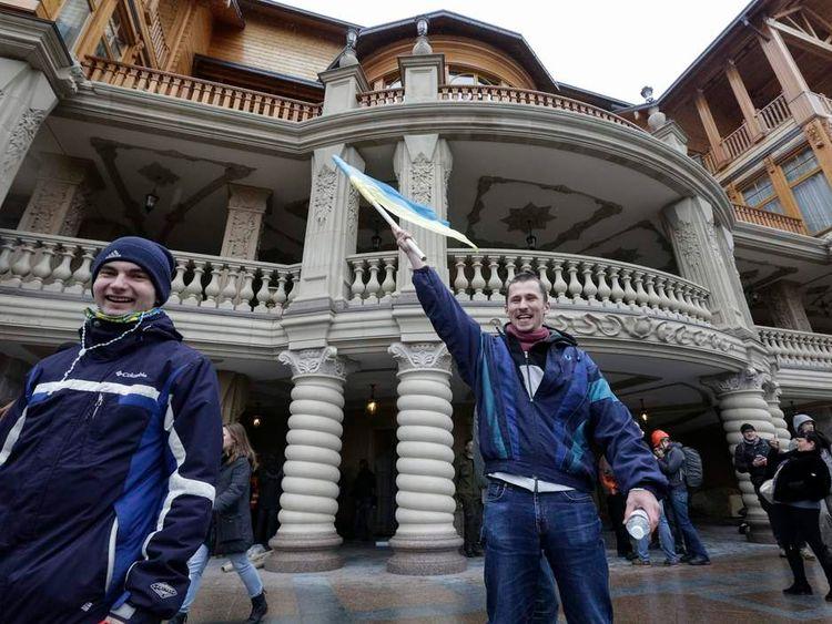 Anti-government protesters in the grounds of the Mezhyhirya residence of Ukraine's President Viktor Yanukovych outside Kiev.