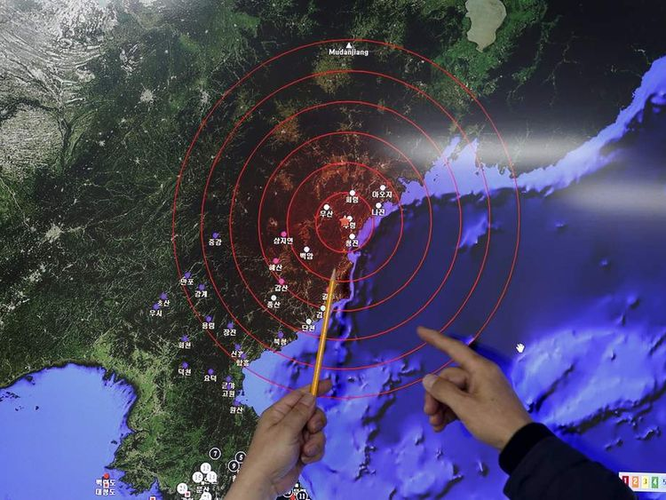 Ko Yun-hwa, Administrator of Korea Meteorological Administration, points at where seismic waves observed in South Korea came from, during a media briefing at Korea Meteorological Administration in Seou