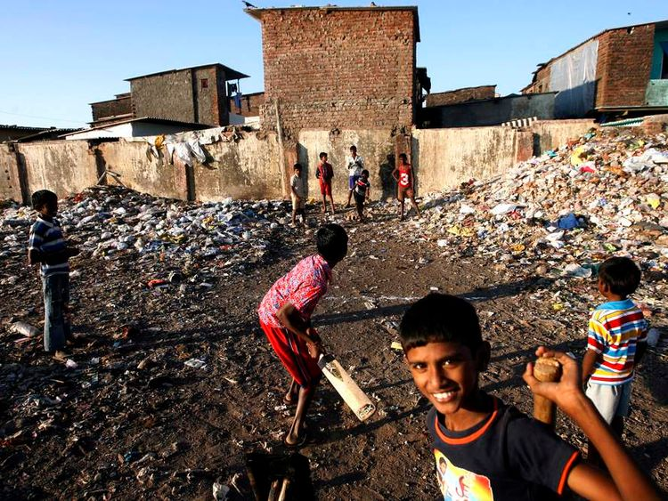 Slum children playing cricket in Mumbai, India