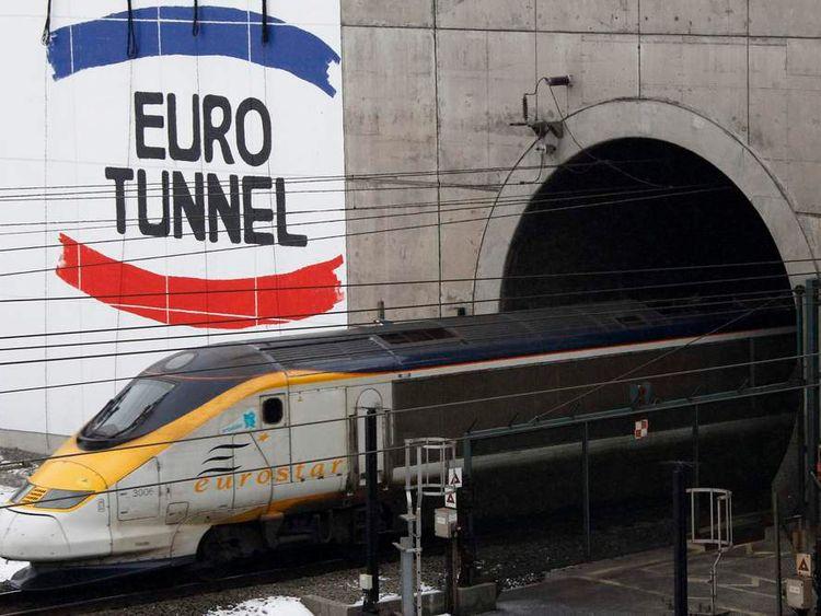 A high-speed Eurostar train leaves the Eurotunnel in France