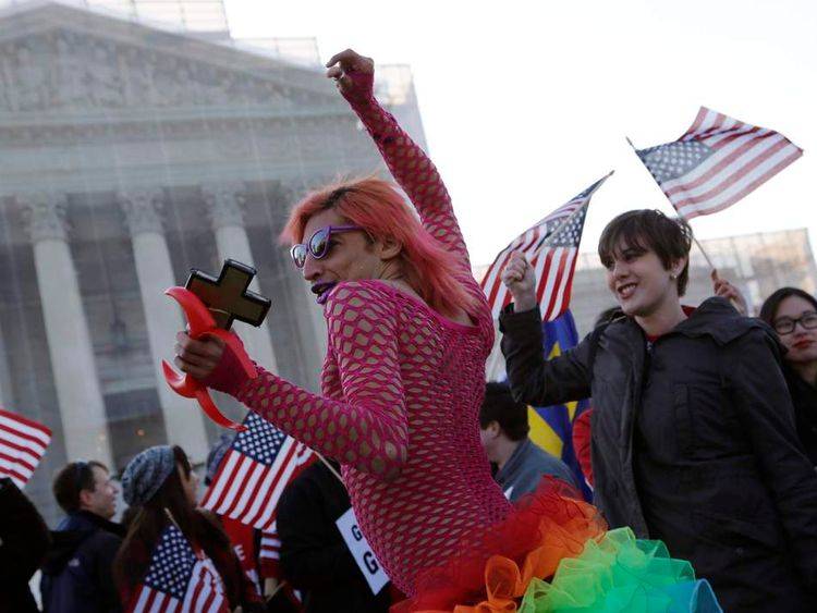 A protester dressed as a devil stands outside of the U.S. Supreme Court in Washington