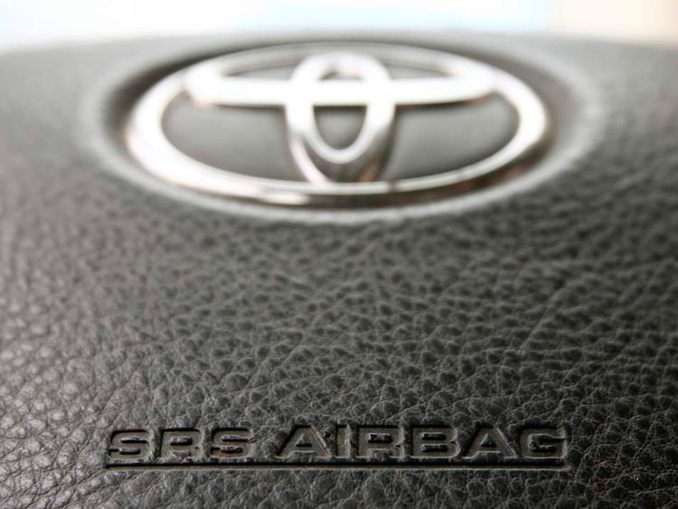 The steering wheel of a Toyota car which contains an airbag is pictured in Vienna