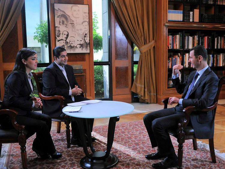 Syria's President Bashar al-Assad attends an interview with Syrian television channel al-Ikhbariya in Damascus