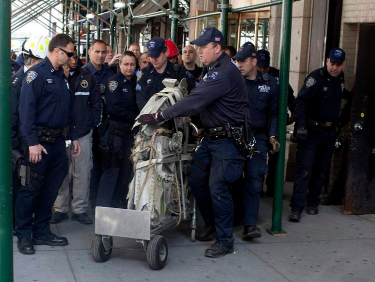 New York Police remove a piece of plane believed to be connected to the 9/11 terrorist attacks from 51 Park Street in New York