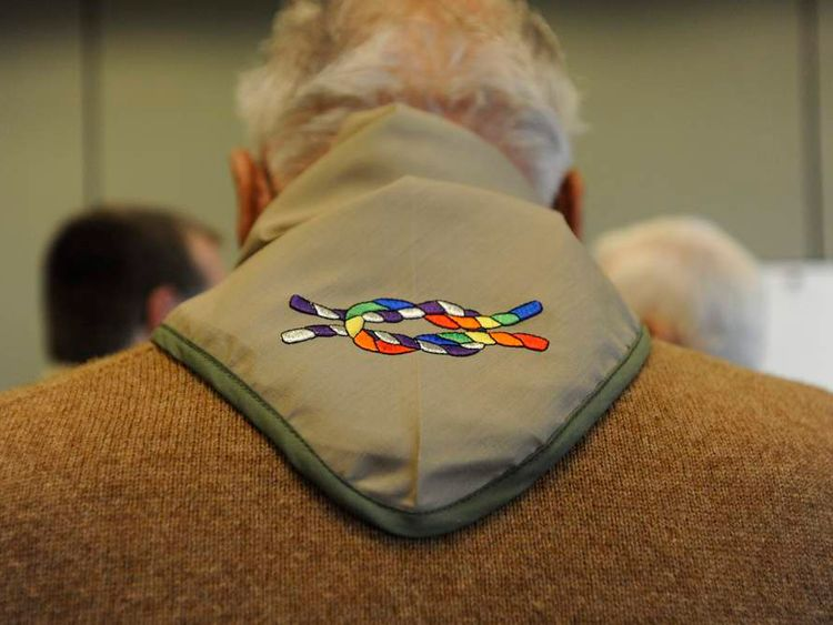 Dave Rice wears a neckerchief embroidered with the Inclusive Scouting Award while talking with supporters at the Equal Scouting Summit in Grapevine