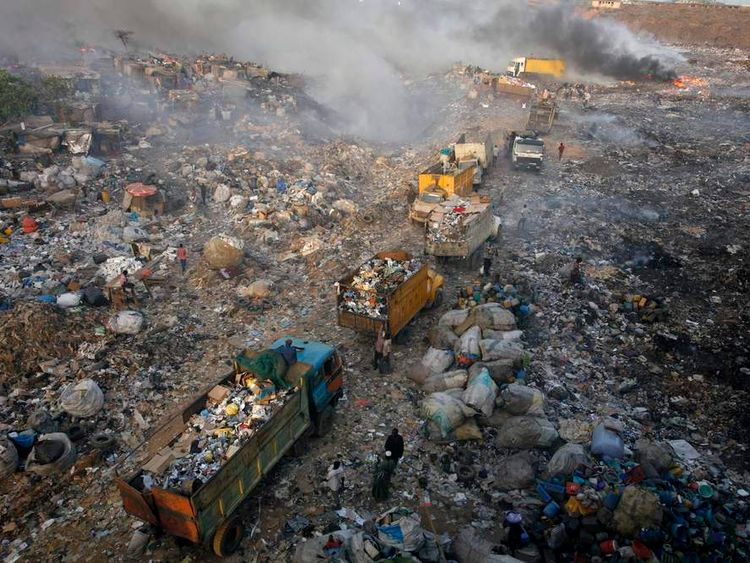 Trucks line up to offload rubbish at Olusosun dump