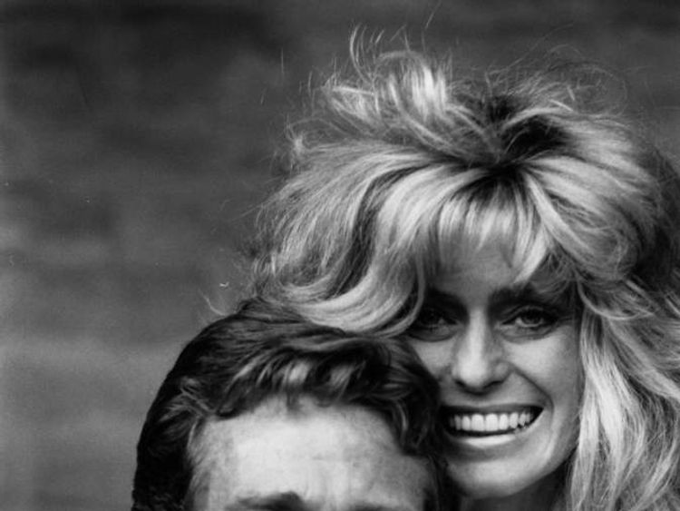 Ryan O'Neal  and Farrah Fawcett in 1984