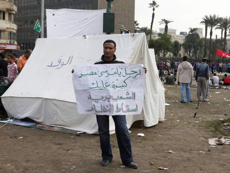 An anti-Morsi protester at a sit-in in Tahrir Square