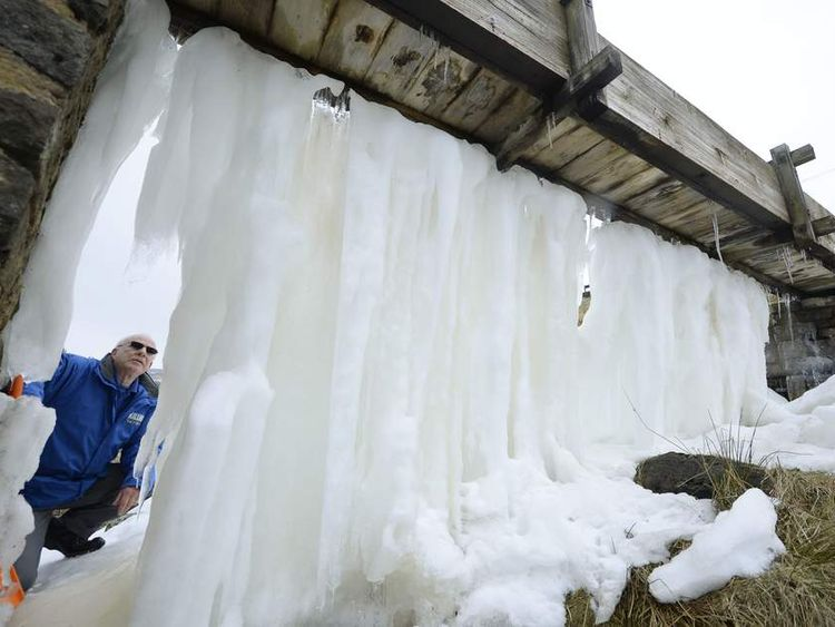 Geoff Lee from Killhope mine Durham Dales takes a look at the ice wall which has formed after recent freezing temperatures.