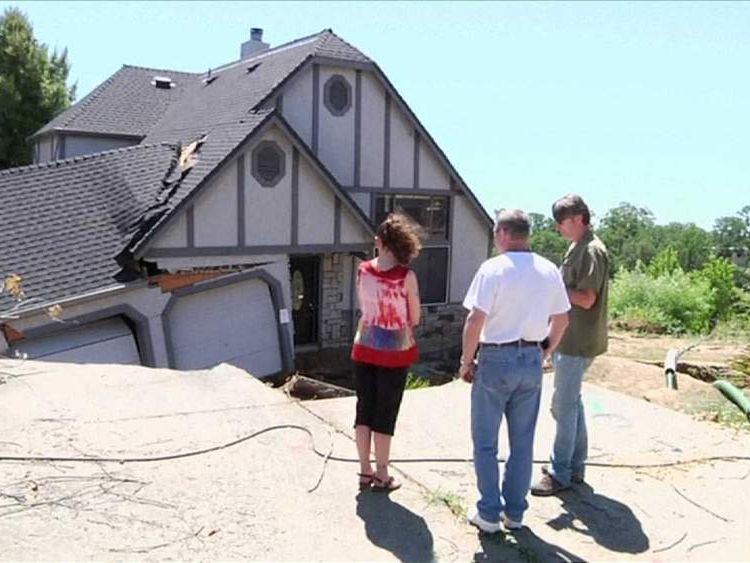 Couple survey sinkhole damage