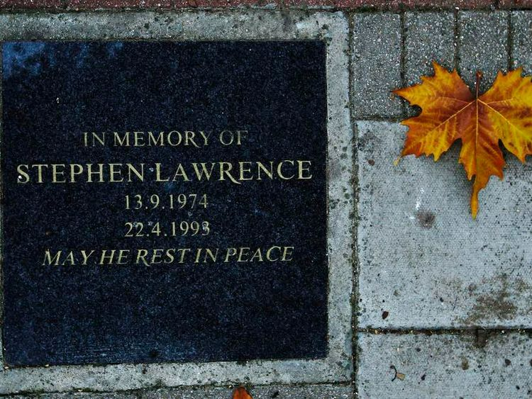A leaf lies next to a plaque in memory of murder victim Stephen Lawrence, next to a bus stop in Eltham where he was killed in 1993 in south east London