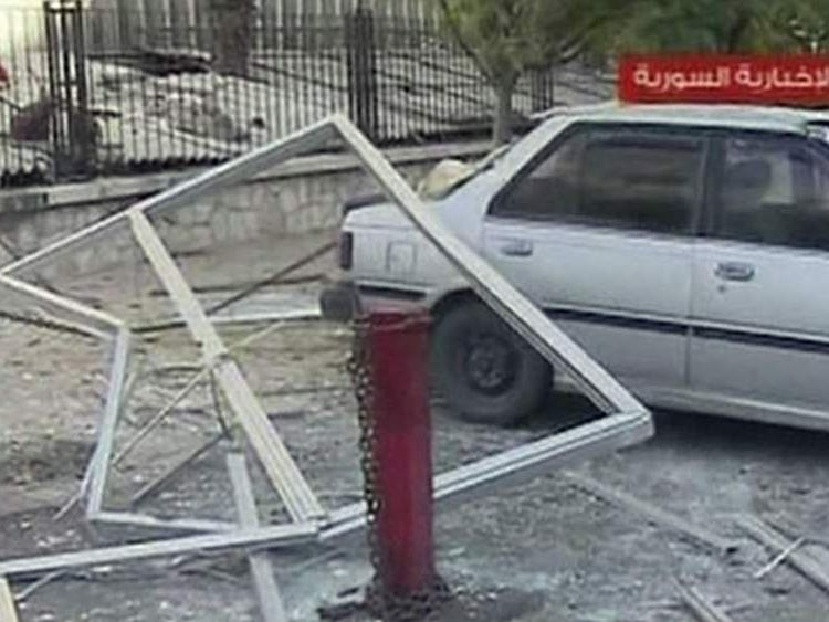 Damage after a bomb attack near the Dama hotel in Damascus, Syria