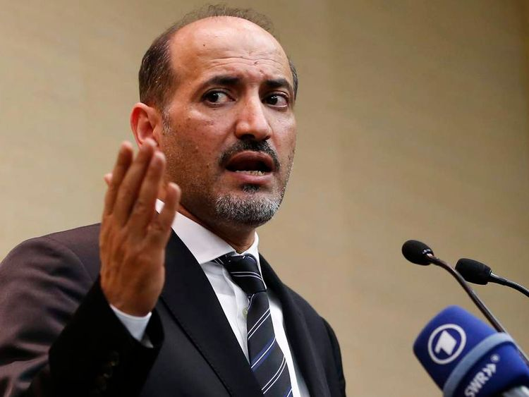 Syrian opposition leader Jarba answers questions during a news conference in Geneva