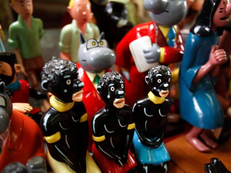 Shelves crammed with figurines from Belgian comic strips Tintin and Le Chat are displayed at the workshop of Congolese artist Kakese in Kinshasa