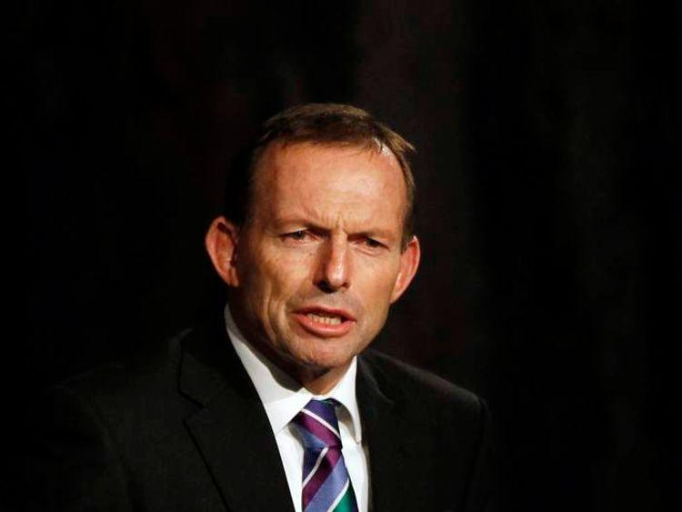 Australian opposition leader Tony Abbott speaks during a dinner for U.S. President Barack Obama at Parliament House in Canberra